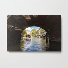 Canal boat going under Amsterdam bridge Metal Print