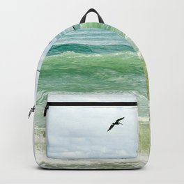 Birds flying above ocean Backpack