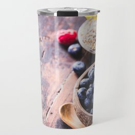 Close-up of fresh fruits and seeds in wooden tray Travel Mug