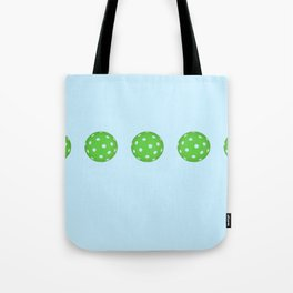 Pickleballs in a row. Green and Blue Tote Bag