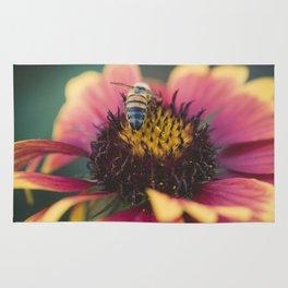 Bee on a flower Rug