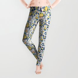 Buttercup yellow, salmon pink, and navy blue flowers on white background pattern Leggings