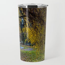 Bench and yellow tree in the autumn park Travel Mug
