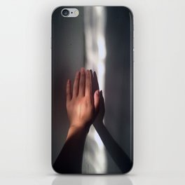 hand in light iPhone Skin