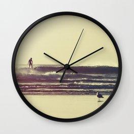 Sunset Surfers Wall Clock