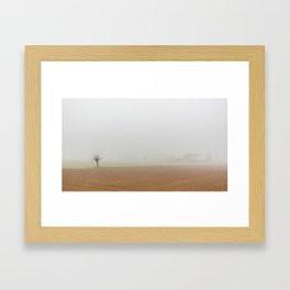 Fallow field in the Po valley with a thick fog Framed Art Print