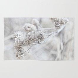 Frozen winter delicate plant Rug