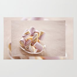 Puffy marshmallows twists on plate Rug