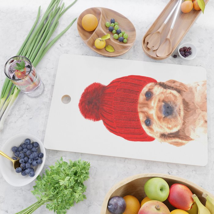 Cocker spaniel puppy with hat Cutting Board