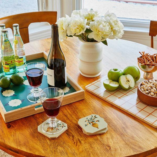 wooden table with serving tray cutting board fruits and drinks