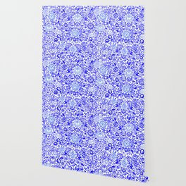Beautiful folk art floral ornament with blue flowers on white background Wallpaper
