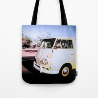 volkswagon Tote Bags featuring vintage vw van in tucson by robertbuttery