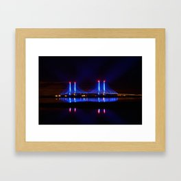 The Indian River Inlet bridge reflecting off the bay as beams of blue light penetrate the night sky Framed Art Print