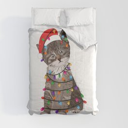Cute cat with Santa Claus hat and light bulb Comforters
