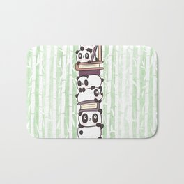PILE OF PANDAS AND BOOKS Bath Mat
