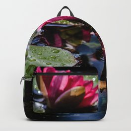 Two water lilies in the sunbeam Backpack