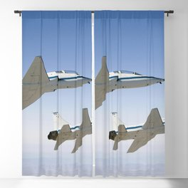 NASA Drydens two T-38A mission support aircraft fly in tight formation Sept 26th 2007 Blackout Curtain