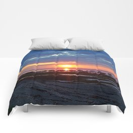 Sunset under Stormy Skies Comforters