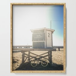 Bike leaning against lifeguard hut on beach Serving Tray