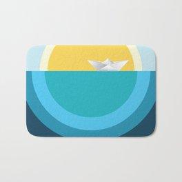 Paper boat in the sea Bath Mat