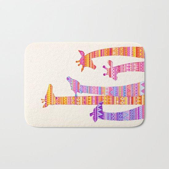 Giraffe Silhouettes in Colorful Tribal Print Bath Mat