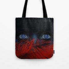 blue eyes behind Tote Bag