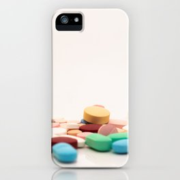 Numerous medicines Medications in the form of tablets. Colored pills on a white background. iPhone Case