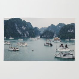 The Boats and Limestone Cliffs of Halong Bay, Vietnam Rug