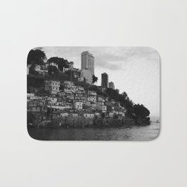 Black and white photo of a favela taken from the water Bath Mat