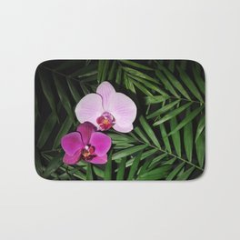Orchids with palm leaves Bath Mat