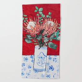 Delft Bird Vase of Proteas on Red Beach Towel