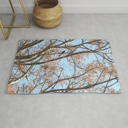 Rowan tree branches with berries and bird Rug