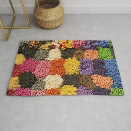 Colorful pattern of balloon nozzles packed in kit Rug