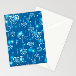 Bright openwork hearts on a light blue background. Stationery Cards