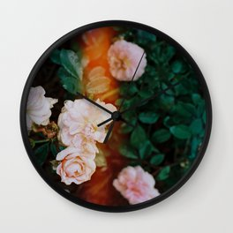 Roses with light leak Wall Clock
