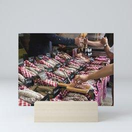 Various sausages at market Mini Art Print