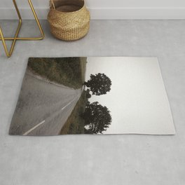 misty road in derbyshire Rug