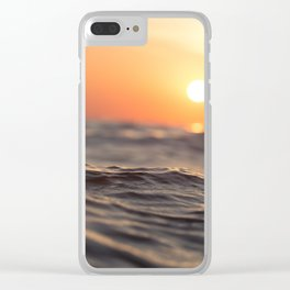 Calm sea with distant sunset Clear iPhone Case