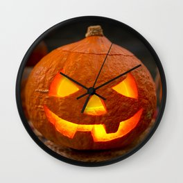 Burning Jack O'Lantern on a rustic table with autumn decorations Wall Clock