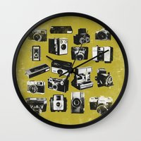 cameras Wall Clocks featuring Cameras by ELCORINTIO