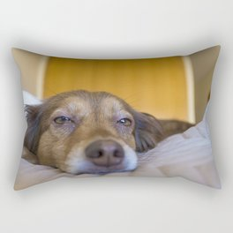 A bored brown dog resting in bed Rectangular Pillow