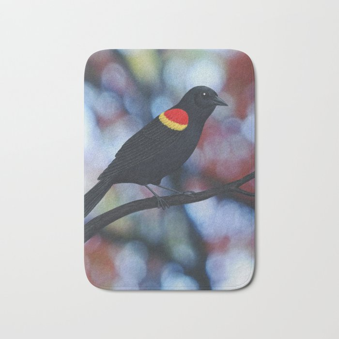 red winged blackbird male bokeh Bath Mat