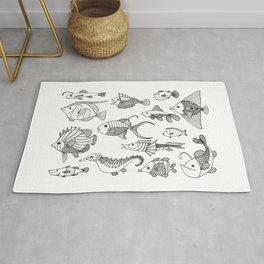 Arrangement of doodle fish Rug