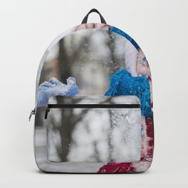 Girl Throwing Snow in Winter Backpack
