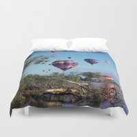 aviation Duvet Covers featuring Hot air balloons over lake by Bruce Stanfield Photographer