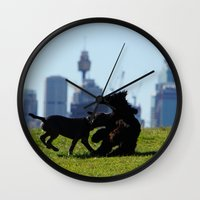 teen titans Wall Clocks featuring Clash of the Titans by Lucas Brown