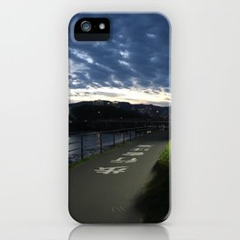 Sunset over a Japanese city iPhone Case