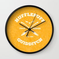 hufflepuff Wall Clocks featuring Hufflepuff Quidditch by Sharayah Mitchell