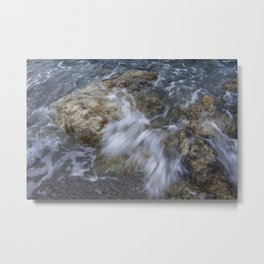 Crashing wave in a rocky beach Metal Print