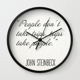 """People don't take trips, trips take people."" John Steinbeck Wall Clock"
